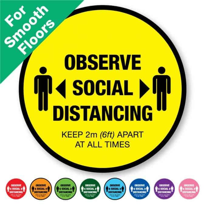 "Round yellow Social Distancing Sticker for smooth floors that says ""Observe Social Distancing"" on the top plus 8 other colours o the bottom"