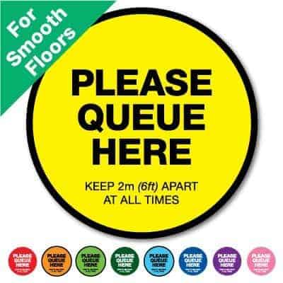 "Round yellow Social Distancing Sticker for smooth floors that says ""Please Queue here"" on the top plus 8 other colours o the bottom"