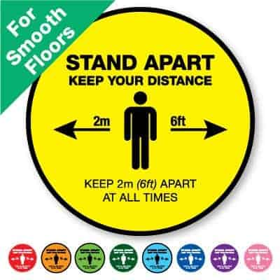 "Round yellow Indoor Social Distancing Stickers for smooth floors that says ""Stand apart keep your distance"" on the top plus 8 other colours o the bottom"