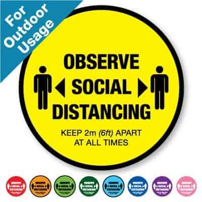"Round yellow Social Distancing Sticker for outdoor usage that says ""One Way System in Operation"" on the top plus 8 other colours o the bottom"