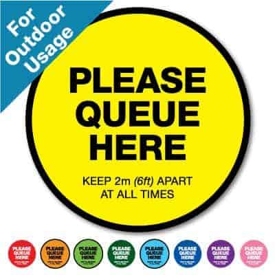 "Round yellow Social Distancing Sticker for outdoor usage that says ""Please Queue here"" on the top plus 8 other colours o the bottom"