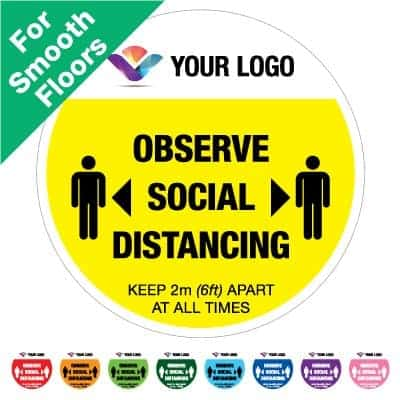 "Round yellow Social Distancing Sticker for smooth floors branded with a logo that says ""observe social distancing"" on the top plus 8 other colours o the bottom"