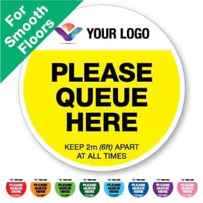 "Round yellow Social Distancing Sticker for smooth floors branded with a logo that says ""please queue here"" on the top plus 8 other colours o the bottom"