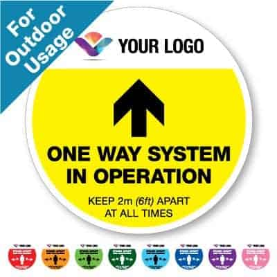 "Round yellow Social Distancing Sticker branded with logo for outdoor usage that says ""One Way System"" on the top plus 8 other colours o the bottom"