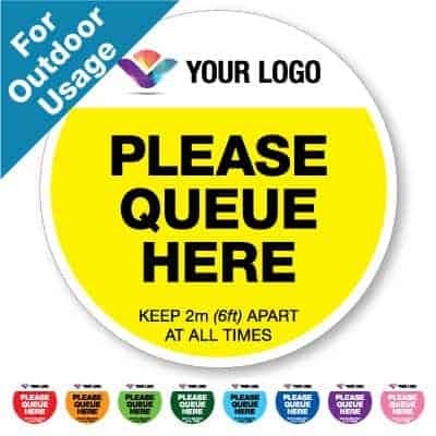 "Round yellow Social Distancing Sticker branded with logo for outdoor usage that says ""Please Queue here"" on the top plus 8 other colours o the bottom"
