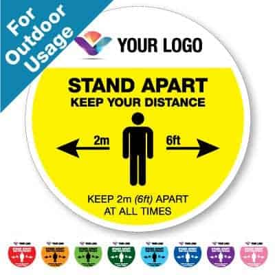 "Round yellow Social Distancing Sticker branded with logo for outdoor usage that says ""Stand Apart 2m"" on the top plus 8 other colours o the bottom"